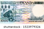 Eastern Gorillas (Gorilla beringei); Canoers on Lake Kivu. portrait from Rwanda 1000 Francs 1988  Banknote. Rwandaa Bank Notes. Rwanda money, Closeup Uncirculated - Collection.