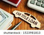 Car Title Loan Concept. Wooden...