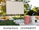 Popcorn and drink on green...
