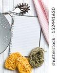 the blank recipe book with pasta tagliatelle - stock photo