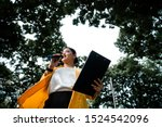 Small photo of A worm eye view of politician woman holding microphone and scrip.