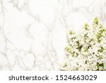 White Lilac Flowers On Marble...
