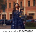 Elegant woman in blue ball gown ...