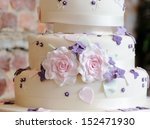 wedding cake closeup with pink... | Shutterstock . vector #152471930