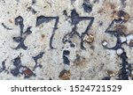The year 1775 carved in stone and painted in black – a detail of an inscription produced that year