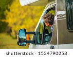 Senior Female Motorhome Driver. Retired Woman and Her Camper Van. Vacation Road Trip. Travel Industry Theme. - stock photo