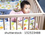cute baby gril lying in wooden... | Shutterstock . vector #152523488