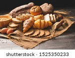 Small photo of Different kinds of bread with nutrition whole grains on wooden background. Food and bakery in kitchen concept. Delicious breakfast gouemet and meal. Carbohydrate organic food cuisine homemade