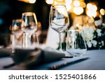 Luxury table settings for fine dining with and glassware, beautiful blurred  background. For events, weddings.  Preparation for holiday dinner night. props for weddings, birthdays, and celeb - stock photo