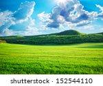 green meadow in mountain.... | Shutterstock . vector #152544110