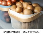 baskets with potatoes and...