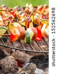 Hot skewers with vegetables on the grill - stock photo