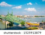 Liberty Bridge And Cityscape...