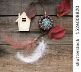 Small photo of Dreamcatcher on a wooden background. Talisman house, talisman. The concept of protection, comfort, fairy tales, magic, love.