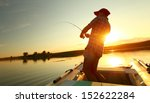 young man fishing on a lake... | Shutterstock . vector #152622284