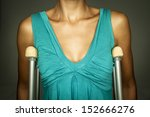 woman in dress with crutches | Shutterstock . vector #152666276