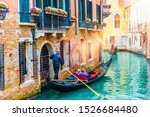 Gondolier Carries Tourists On...
