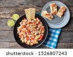Traditional surimi crab ceviche with cucumber and tomato on wooden background