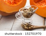 pumpkin seeds in bowl on white... | Shutterstock . vector #152701970