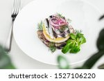 Stock photo appetizer food salted herring butter and red onion on white plate selective focus horizontal 1527106220
