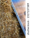 stacks of straw and solar panel.... | Shutterstock . vector #1527237389
