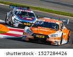 Small photo of Moscow, Russia - July 21, 2017: Jamie Green (Audi RS5 DTM) overtake Tom Blomqvist (BMW M4 DTM) at DTM stage at Moscow Raceway