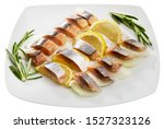Stock photo fillet herring with rosemary onion and lemon isolated over white background 1527323126
