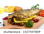 Stock photo baked herring with lemon and spices on a white wooden background tasty fish dish 1527447809