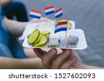 Stock photo amsterdam street food herring with onions and pickled cucumbers 1527602093