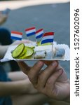 Stock photo amsterdam street food herring with onions and pickled cucumbers 1527602096