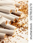 Small photo of Cigarettes isolated on white background. Addiction to smoking, harm of tobacco smoke.