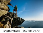 Small photo of Climber in Austrian Alps ascending the rocky ridge