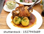 Small photo of Schweinshaxe, in German cuisine, is a roasted ham hock (or pork knuckle). The ham hock is the end of the pig's leg, just above the ankle and below the meaty ham portion.