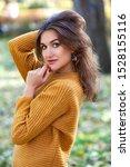 pretty woman wearing sweater... | Shutterstock . vector #1528155116