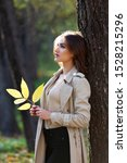 pretty woman holding a leaf and ... | Shutterstock . vector #1528215296