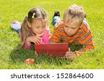 a boy and a girl are looking at ... | Shutterstock . vector #152864600