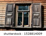 An Old Window With Wooden Fram...