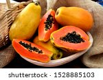The Papaya Fruits In A Wooden...