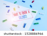 Small photo of Conceptual hand writing showing Want To Know A Secret Question. Business photo text to divulge a confidential vital information Colored clothespin paper reminder with yellow blue background.