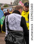 Small photo of Police Liaison At Work At The Blauwebrug At The Climate Demonstration From The Extinction Rebellion Group At Amsterdam The Netherlands 2019