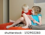 two children playing on a... | Shutterstock . vector #152902283