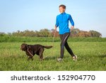 Stock photo running with dog 152904770