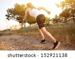 sporty fitness girl running on... | Shutterstock . vector #152921138