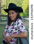 pretty hispanic woman in black... | Shutterstock . vector #152946098