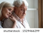 Small photo of Senior spouses remember sad moments of life together, middle-aged adult daughter snuggle up to elderly father sharing his sorrows and heartache, embrace as symbol of empathy and compassion concept