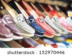 row of slip on shoes in a... | Shutterstock . vector #152970446