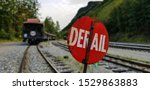 Red Derail Sign On Railroad...