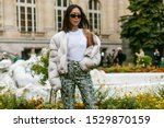 Small photo of PARIS, FRANCE - SEPTEMBER 25, 2019: Aimee Song seen before MAISON MARGIELA show, during Paris Fashion Week Womenswear Spring/Summer 2020.