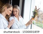 young women holding christmas... | Shutterstock . vector #1530001859