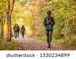 Woman Walking In Autumn Forest...